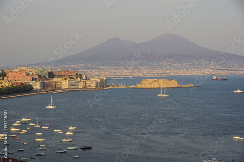 Staande foto Napels Napoli (Naples) and mount Vesuvius in the background at sunset in a summer day, Italy, Campania