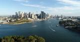 Sydney Barangaroo modern business district waterfront in aerial backward flying over Goat Island.  - 191751616