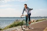 Young man biking - 191756279