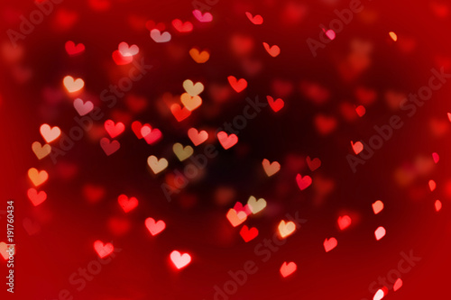 Valentine's day background. Hearts bokeh and shine