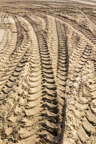 Aluminium Trekker Tractor tyre tracks in beach sand