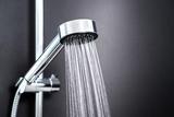 Water running from shower head in bathroom with dark black background. Simple stylish and modern Scandinavian home interior design. - 191775432