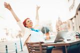 Successful Businesswoman On A Break In A Street Cafe