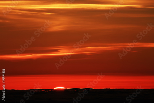 Foto op Canvas Rood traf. Sunrise over the Atlantic Ocean, seen from Pico volcano (2351m), Pico Island, Azores, Portugal, Europe