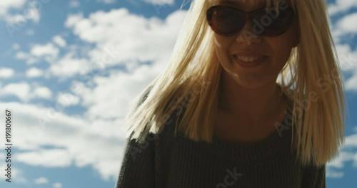 Caucasian female dressed warm clothing enjoying being outdoors fresh air beach