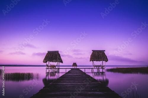 Foto op Aluminium Zee zonsondergang The dock, El Remate