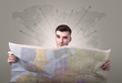 Quadro Young man holding map