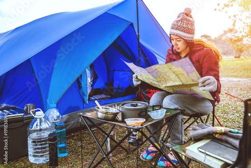 Fotobehang Donkerblauw Asian women travel relax camping in the holiday. camping on the Mountain. sit relax view map travel on the chair. Thailand