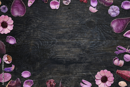 Plakat Floral decorations on black wooden desk with free space for text.