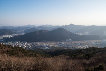 City and mountains, view from mountain range