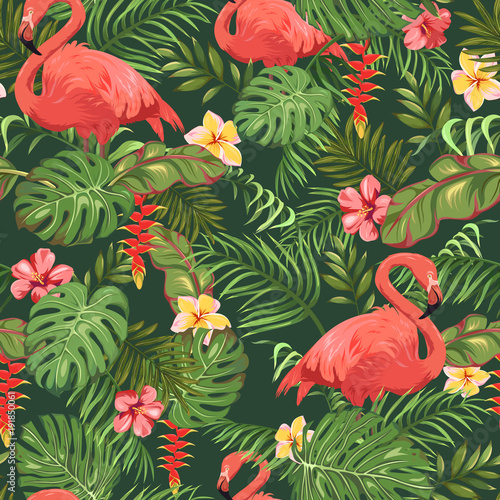 Seamless pattern with tropical leaves, exotic flowers and beautiful flamingos