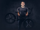 A handsome man with BMX in a studio. - 191853627