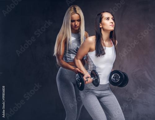 Studio portrait of two sporty women.