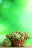 Broccoli in basket on wooden table - 191860490