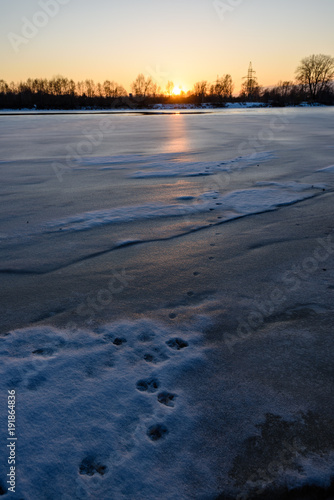 In de dag Nachtblauw colorful winter sunset on frozen river ice