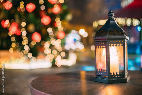 Christmas Lantern With Burning Candle On Bright Blurred Christmas - 191868610