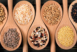 Variety of rice and grains in wooden spoons close up - 191870433