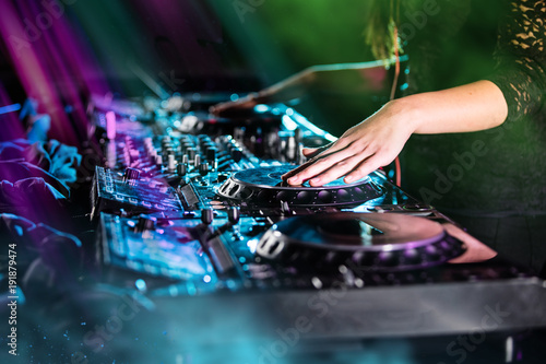 Fotobehang Muziek Dj mixes the track in the nightclub at a party
