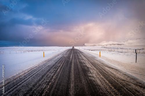 Fotobehang Lichtroze frozen highway at iceland
