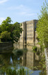Picturesque old industrial architecture by the River Avon in spring sunshine, Bradford on Avon, Wiltshire, UK