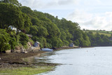 Peaceful early summer morning on picturesque boat moorings in the Helford Estuary at old fashioned Port Navas, Cornwall, UK - 191897489