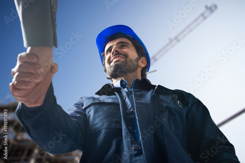 Engineer shaking hands with a customer