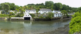 Picturesque old cottages line the waters edge in Helford village on the Helford Estuary in Cornwall, UK - 191899099