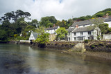 Picturesque old cottages line the waters edge in Helford village on the Helford Estuary in Cornwall, UK - 191899658