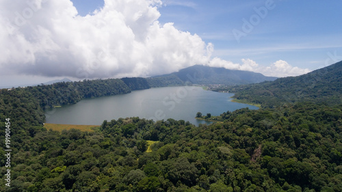 Foto op Canvas Bali Aerial view of Lake Tamblingan, a caldera lake at Bali. Beautiful lake with turquoise water in the mountains of the island of Bali. Landscape, lake among mountains, sky, clouds.