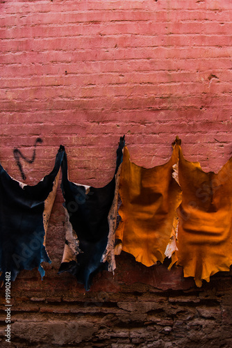 Poster Marokko Goat skins druing on wall in local tannery,Morocco
