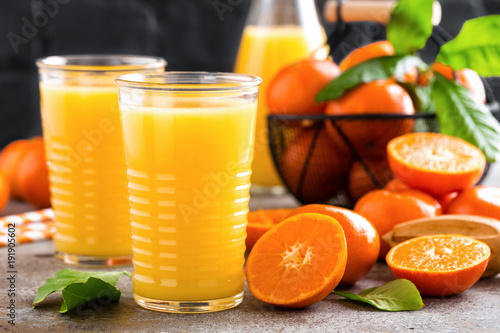 Foto op Canvas Sap Mandarin orange juice. Refreshing summer drink. Fruit refreshment beverage