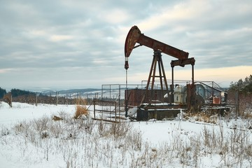 Oil well on a winter landscape