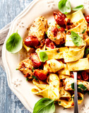 Tagliatelle pasta with grilled chicken fillet and cherry tomatoes - 191911447