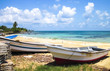 Fishing boats rest on a tropical white sand beach on the Corn Islands, Nicaragua.