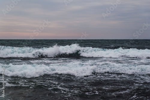 Fotobehang Donkergrijs Storm on the sea in cloudy weather at sunset