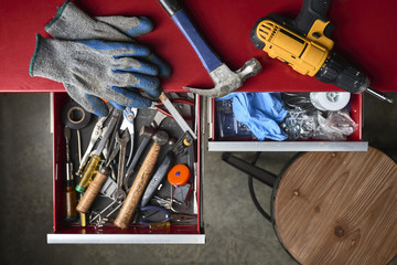 an assortment of tools in drawers in a workshop
