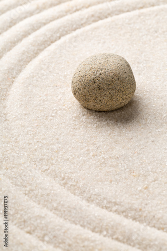 Foto op Plexiglas Stenen in het Zand Zen sand and stone garden with raked curved lines. Simplicity, concentration or calmness abstract concept