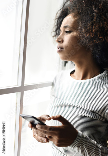Serious woman using a smartphone