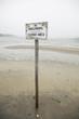 No Shellfishing sign on beach in Chatham, Massachusetts on Cape Cod.