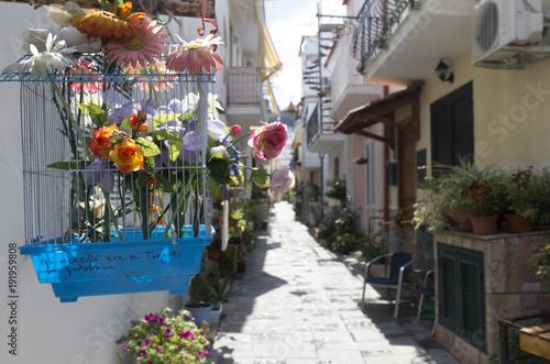 Tuinposter Napels ischia casamicciola italy street flowers chair