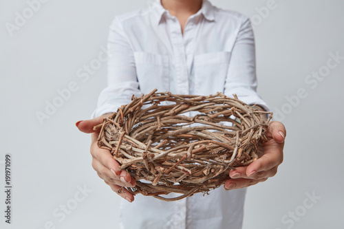 Girl gives a nest of twigs