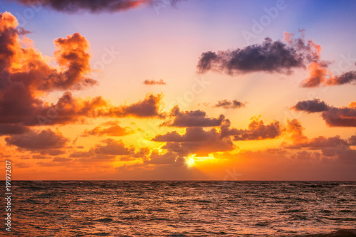 Poster Oranje eclat Beautiful sunrise over the sea