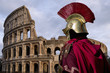 Old Roman soldier, in front of the Colosseum in Rome