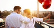 Beautiful couple in love at sunset hugging and dating
