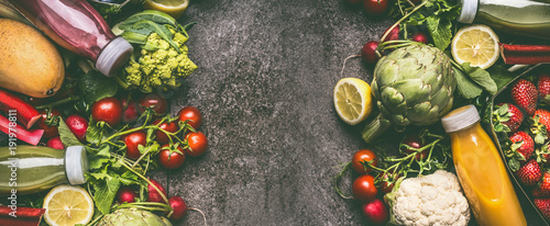 Various fresh colorful organic vegetables, fruits and berries smoothie with ingredients in bottles on gray granite table , top view, banner or template. Healthy dieting and antioxidant beverages