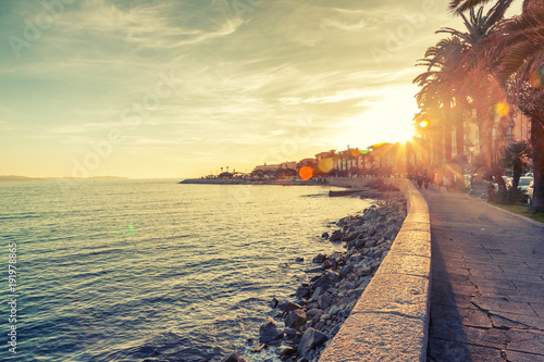 Foto op Canvas Zee zonsondergang Beautiful cityscape, the promenade in Ajaccio at sunset, travel to Corsica, France