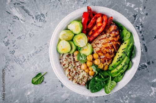 Staande foto Boeddha Vegetable bowl lunch with grilled chicken and quinoa, spinach, avocado, brussels sprouts, paprika and chickpea