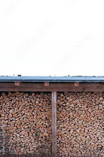 Foto op Plexiglas Brandhout textuur Lodge for firewood in wintertime with space for text