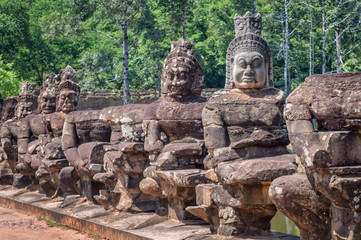 Row of statues at the entry gate of Angkor, Siem Rep, Cambodia