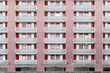 Housing block faced with panels in red colour at golden lane estate in London